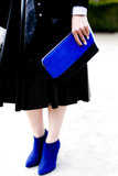 A black ensemble got a jolt of excitement via bright blue accessories.