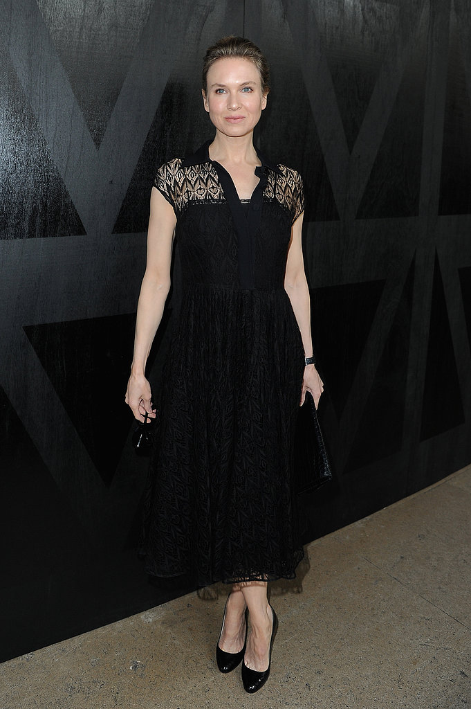 Renée Zellweger got dressed up in a ladylike black lace Prada dress and classic Prada pumps at Miu Miu.