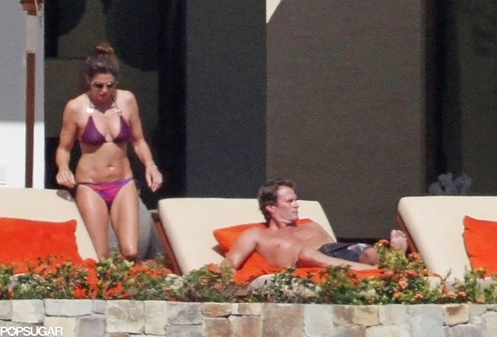 Cindy Crawford made a splash in a purple two-piece in Mexico over New Year's Eve in 2011.