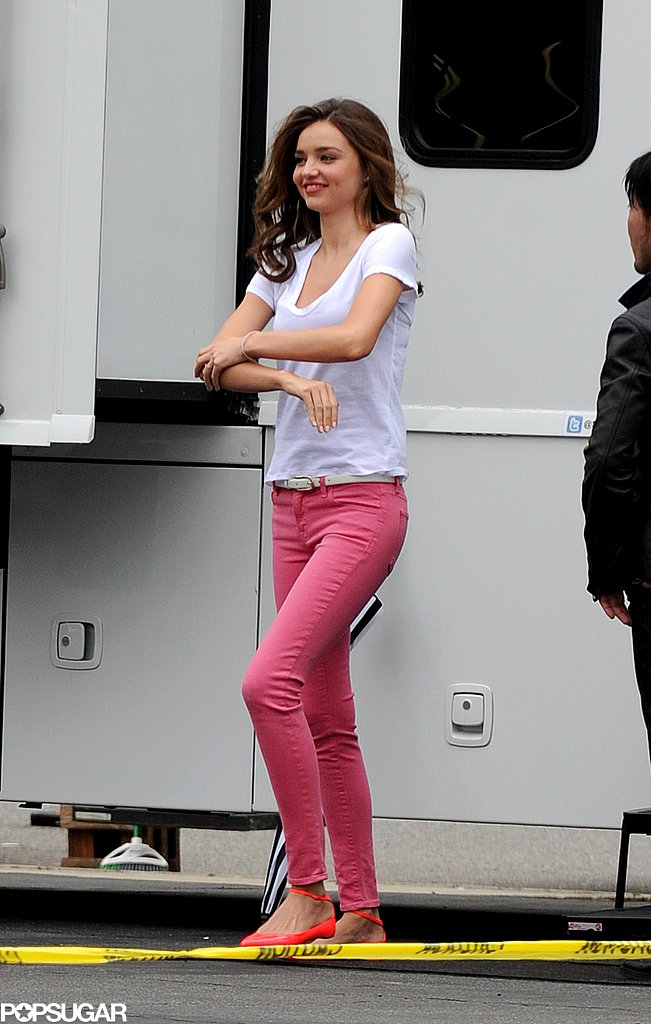 Miranda Kerr wore pink pants and a white t-shirt.