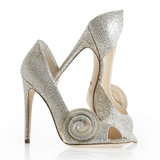 We chatted with Jerome C. Rousseau, who designed a pair of silver heels for the new movie Oz the Great and Powerful.