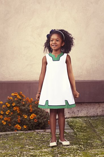 "Mimivail's Crisp White Pique Sundress ($125) is inspired by ""Bridget,"" a 7-year-old Bostonian who lives for outdoor adventures with her older brother, Sam."