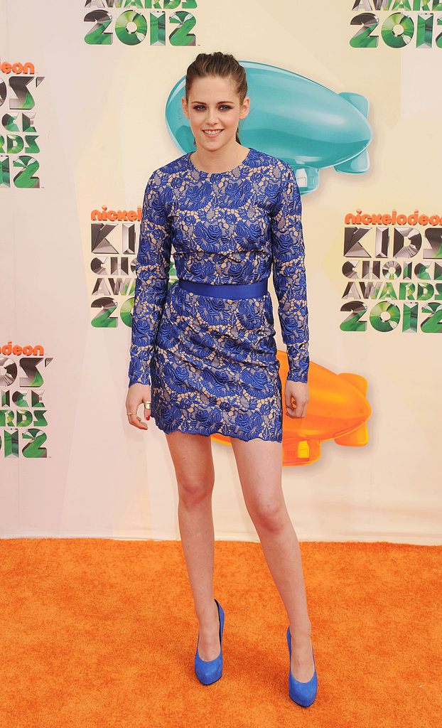 Kristen Stewart showed off her legs in a short dress on the orange carpet at the 2012 show.
