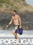 Liam Hemsworth hit the beach shirtless.