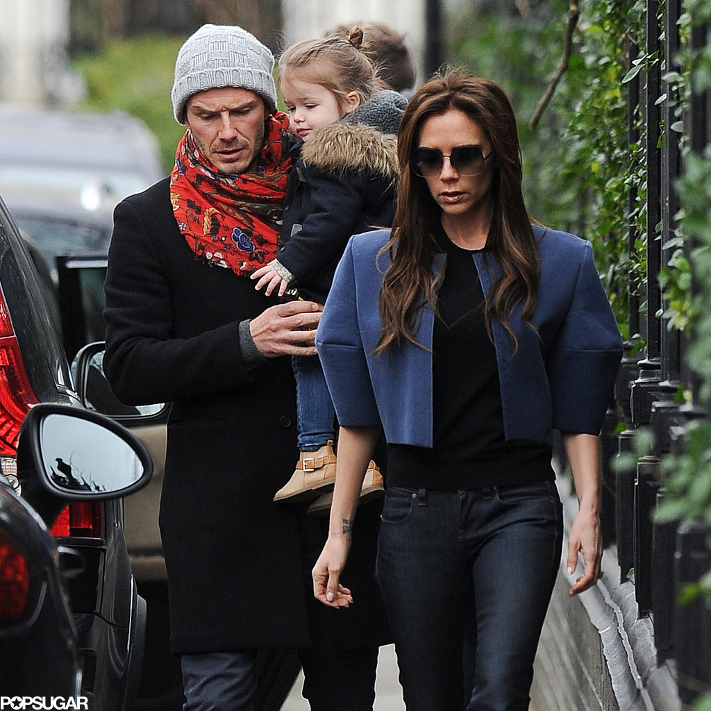 David Beckham carried Harper while out in London with Victoria.