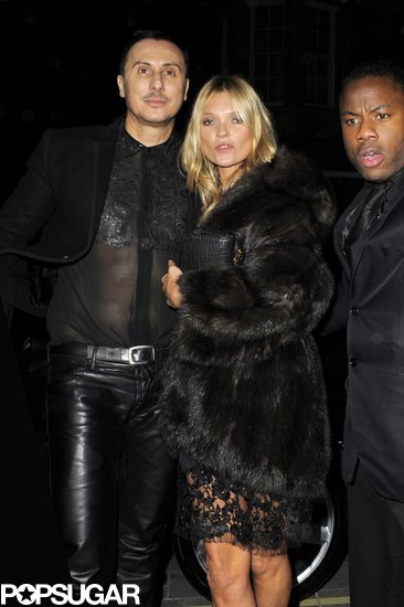 Kate Moss wrapped up with a big fur coat in London on Monday night.