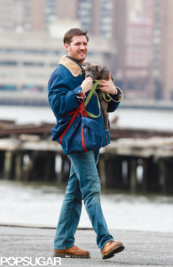 Tom Hardy Cuddles Up to a Canine Costar on Set