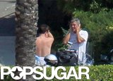 George Clooney caught up with his shirtless pal Bono during a bike ride around Lake Como in August 2011.