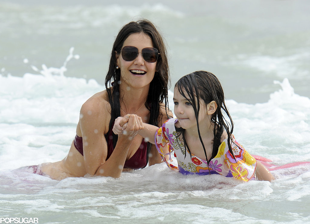 Katie Holmes and Suri Cruise spent a day at the beach in Miami in July 2011 while Tom Cruise filmed Rock of Ages.