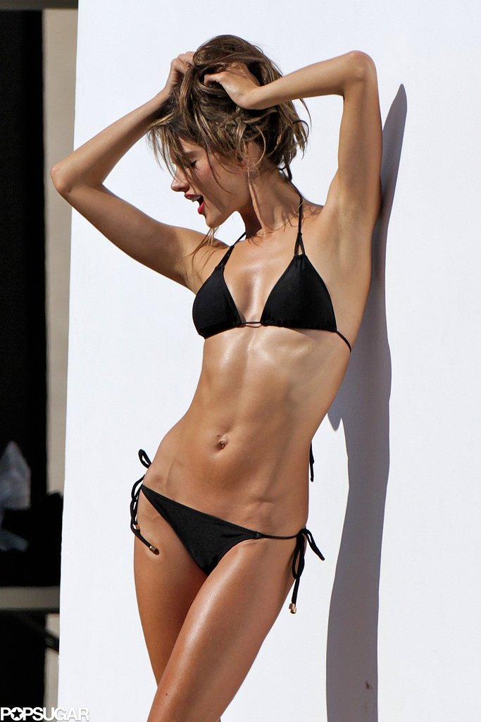 Alessandra Ambrosio Playfully Poses in a Tiny Black Bikini