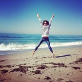 Alessandra Ambrosio got some air on the beach in one of her own designs. Source: Instagram user alecambrosio