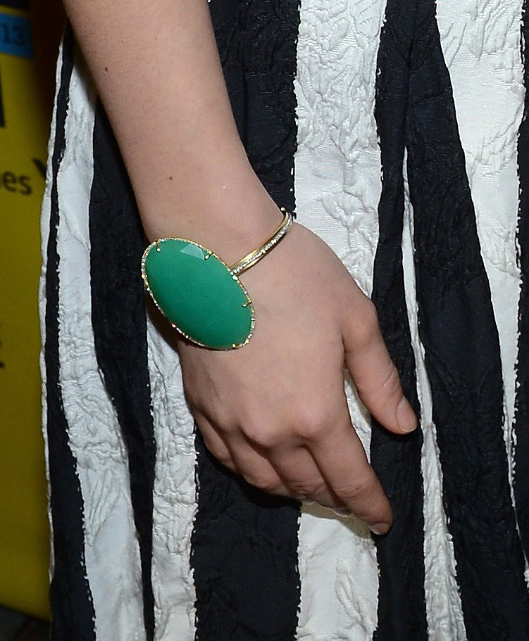 Olivia added a shot of color to her with this bold Irene Neuwirth cuff bracelet.