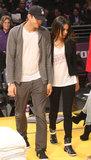Mila Kunis cheered on the Lakers in February in a team shirt, black skinnies, and high-top sneakers — a classic, low-key game look.