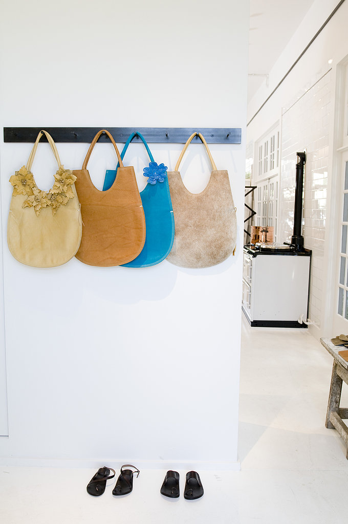 A utilitarian coatrack provides a nice contrast for colorful handbags. Consider installing one in your closet to hold scarves and necklaces.  Photo courtesy of Angie Silvy