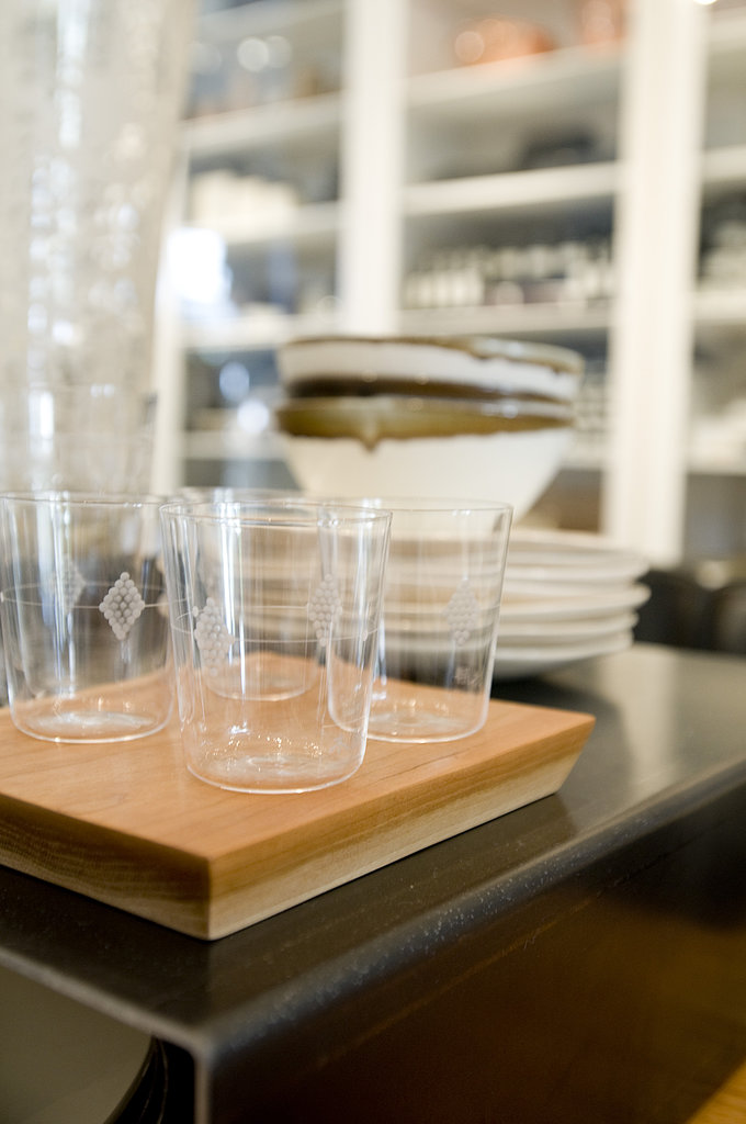 Paper-thin glassware matches the space's airy aesthetic, but delicate designs keep them from feeling too modern. This bar set has a similar look and feels good in the hand.  Photo courtesy of Angie Silvy