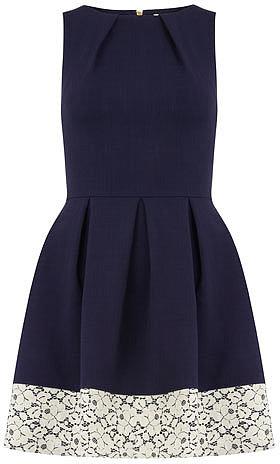 Navy contrast hem pleat dress