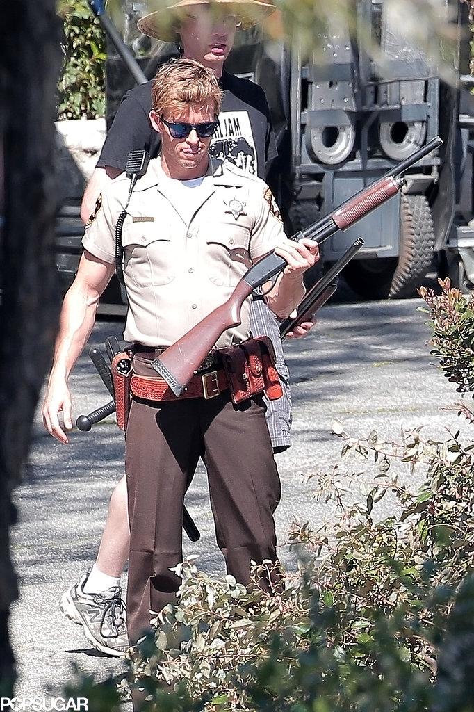 Ryan Kwanten carried a prop rifle on set.