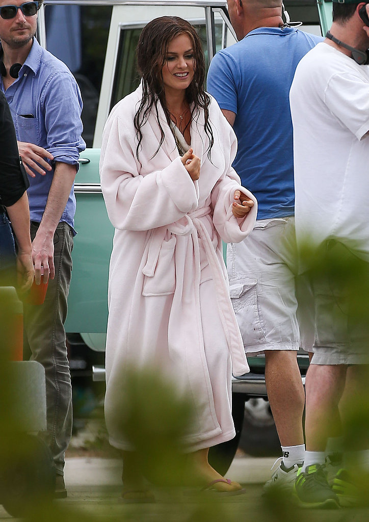 Isla Fisher bundled up in a robe after filming a water scene.