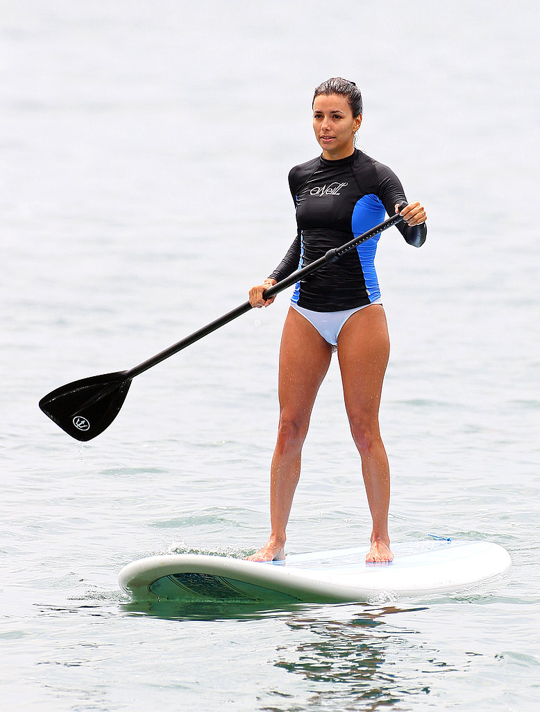 Bikini-clad Eva Longoria went paddleboarding in a bikini in LA in July 2012.