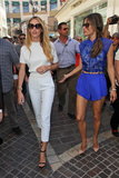 Victoria's Secret angel Candice Swanepoel walked through The Grove in LA wearing white up to (a short-sleeved blouse with cropped trousers) and black on bottom via ankle-strap sandals.