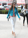 While strutting her svelte stuff through the streets of LA, Alessandra Ambrosio showed off an eclectic pairing: turquoise leather biker jacket with a printed top and ripped skinny jeans.
