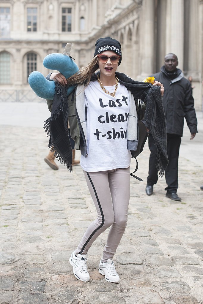 "Cara Delevingne wore her ""last clean t-shirt"" with tuxedo jeans on the streets during Paris Fashion Week."