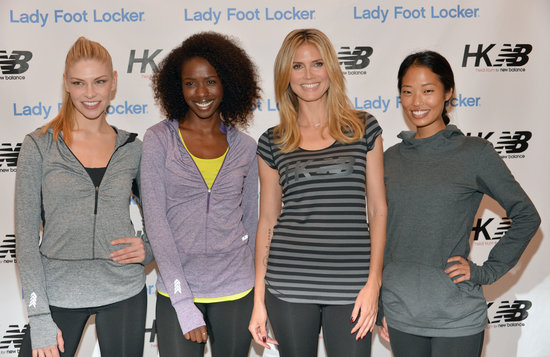 Heidi Klum posed with models at the launch of her collection for New Balance.
