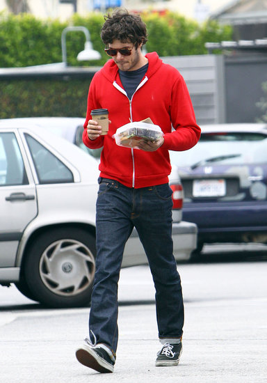 Adam Brody wore a red hoodie for his solo outing in LA.