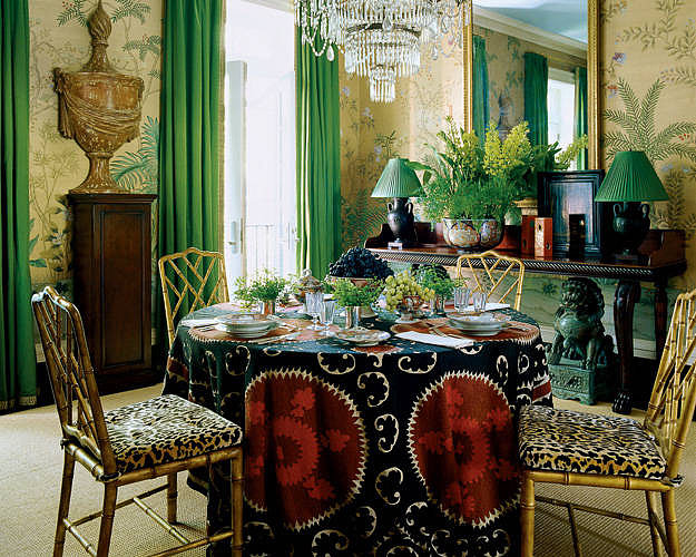 To bring life and freshness into this dining room, green plants accent the wallpaper and side table; green curtains complete the space! Source: Simon Upton for Elle Decor