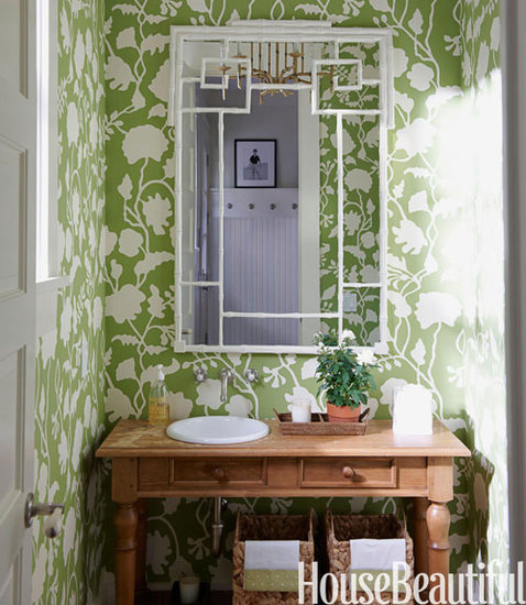 Because of its small size, a bold green wallpaper gives this powder room casual elegance.  Source: James Merrell for House Beautiful