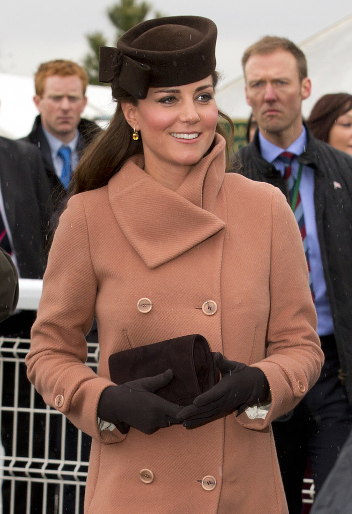Kate Middleton wore a tan coat.