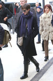 On another day out in the City of Light, Anne layered up in a black coat, a purple scarf, black rain boots, and her python-print Stella McCartney bag.