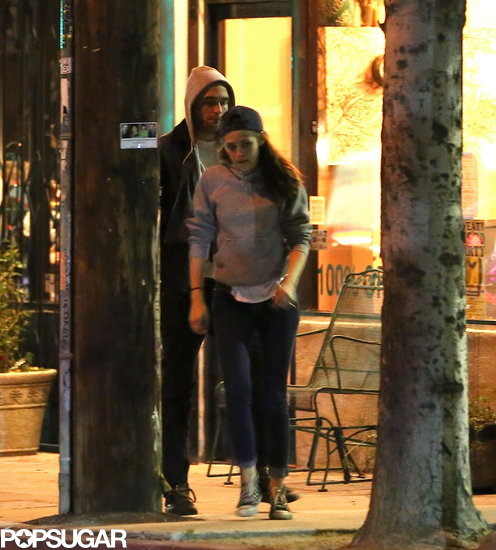 Robert and Kristen wore matching sweatshirts for date night.