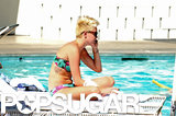 Miley Cyrus lounged poolside in a bikini.