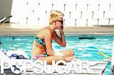 Miley Cyrus lounged poolside in a bikini.