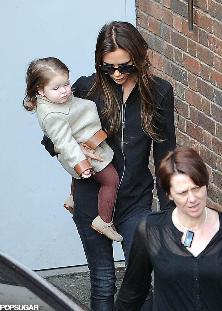 Victoria Beckham carried Harper in London.