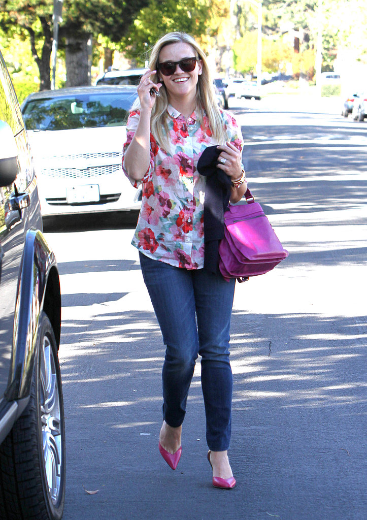 Reese Witherspoon's floral blouse, matching pink Proenza Schouler bag and pumps added major oomph to her denim in LA.