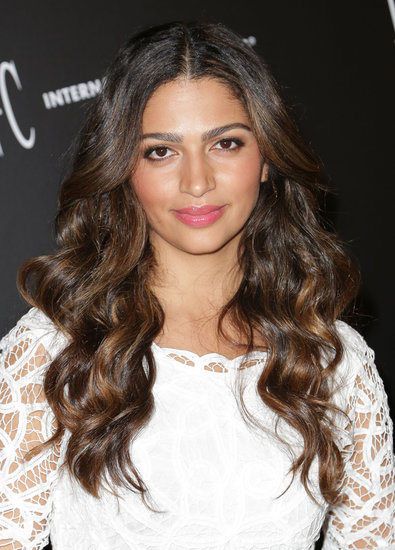 Camila Alves showed us how to master rosy pink cheeks. Complete the flushed look with shimmering champagne shadow, a touch of liner, and a matching pink gloss on the lips.