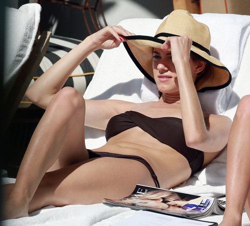Allison Williams lounged in a brown bikini with a straw hat during a trip to Miami in February.