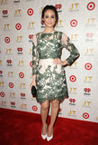 At the iHeartRadio 20/20 album release party in LA, Emmy Rossum matched her floral-embroidered limited-edition Topshop dress with sharp white pumps.