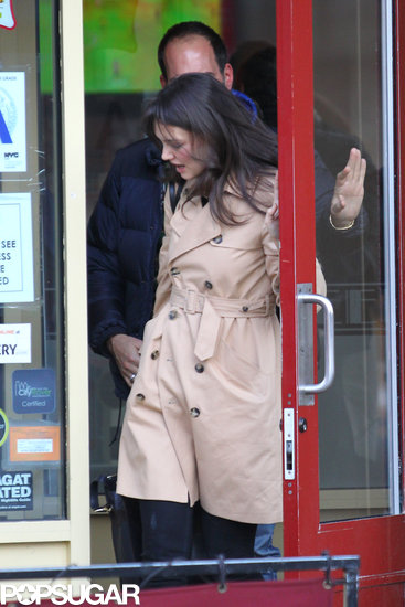 Katie Holmes left a restaurant with a mystery man.