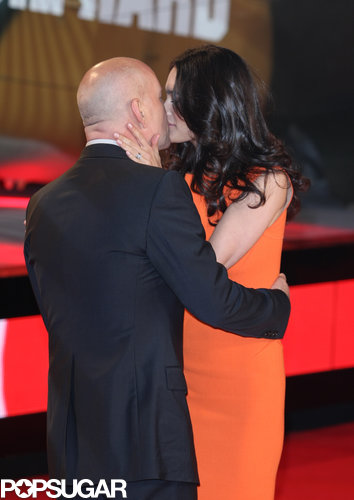 Bruce Willis and Emma Heming shared a moment on the red carpet in London in February 2013.
