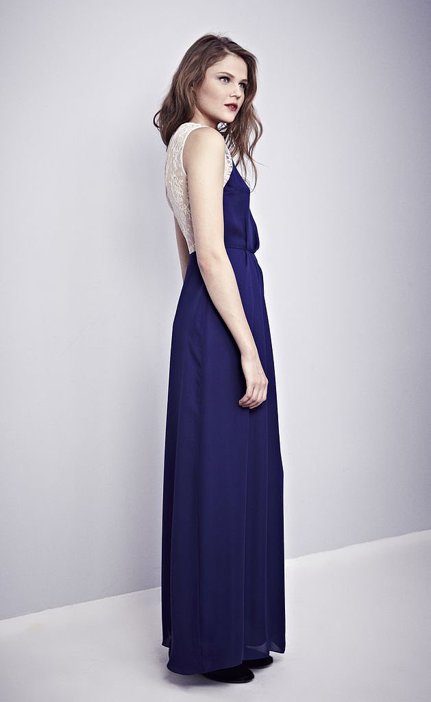 We adore the mix of navy and white in this Misha Nonoo gown, which features a French-lace shoulder and back detail.