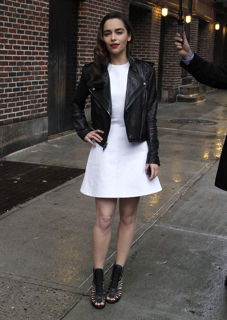 Emilia showed off her edgier side in a little white dress topped with a black leather biker jacket for her appearance on David Letterman in NYC. Her choice of footwear fed into her tough-girl vibe, while red lips added a touch of femme.