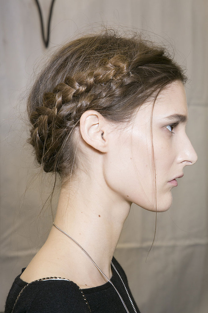 Mesh your milkmaid braids and your reverse milkmaid braids to create an entire crown of plaits for some royal flair, like these ones at Viktor & Rolf.