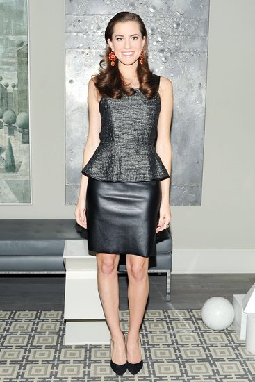 Allison Williams made an on-trend fashion match when she paired a metallic peplum blouse with a black leather skirt at a Barneys New York event in NYC. We also love the pop of color via her orange-and-red statement earrings by Irene Neuwirth.  Billy Farrell/BFAnyc.com