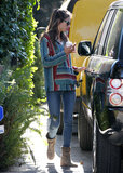 Alessandra Ambrosio looked laid-back in a striped sweater, ripped skinny jeans, and taupe boots in LA.
