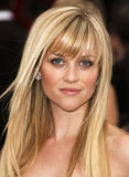 At the 2007 Academy Awards, Reese showed off sleek blond hair, which she coupled with brow-grazing bangs. This iconic look has inspired many fringed haircuts.