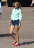 Taylor Swift dressed in jean shorts and bright yellow shades for her new music video in Downtown LA on Saturday.