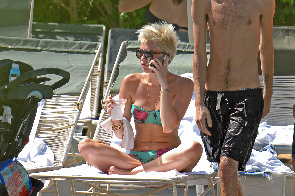 Miley Cyrus wore a bikini to relax poolside at the Ace Hotel in Palm Springs.